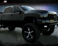 black-chevy-truck-jacked-up-picture